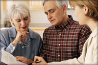 older couple discussing an estate with their attorney