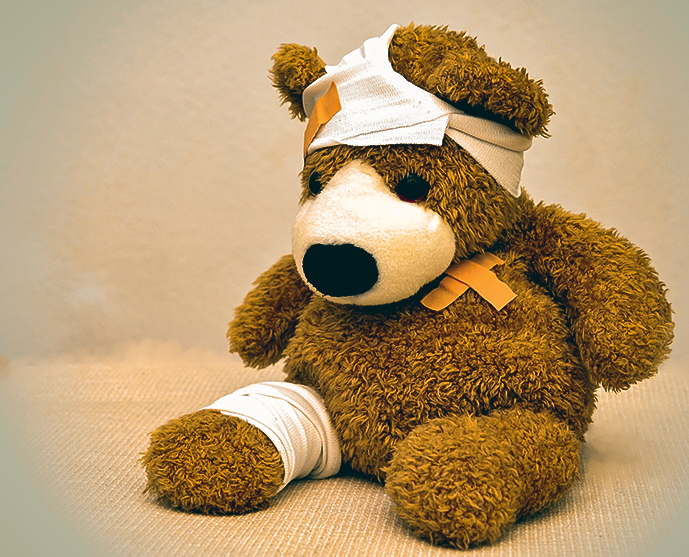 a teddy bear with various bandages